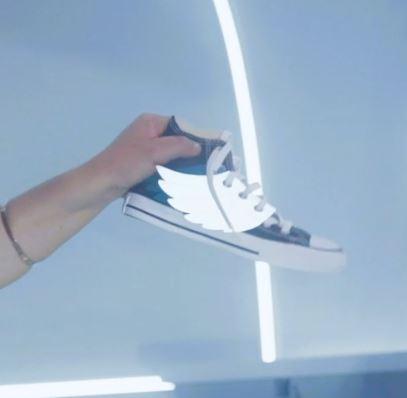 Ali per scarpe in materiale riflettente